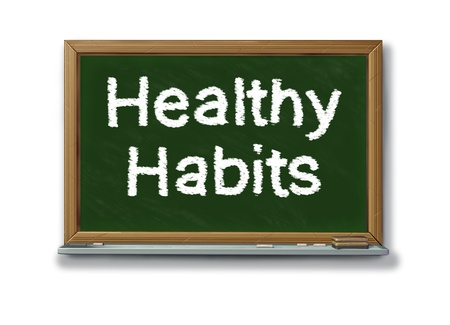 Healthy habits on a school black board representing the concept of good health oriented behavior routine that involves mental and phisical health choices for human well being and a successful lifestyle.