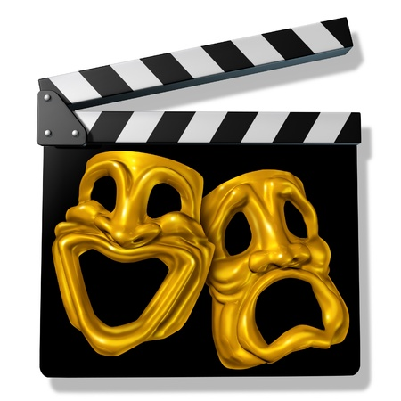 funny movies: Comedy and tragedy symbol on a black clap board representing the concept of movies on a film slate.