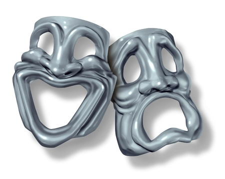 humor: Tragedy and comedy symbol with a happy mask and a sad face made of silver. Stock Photo