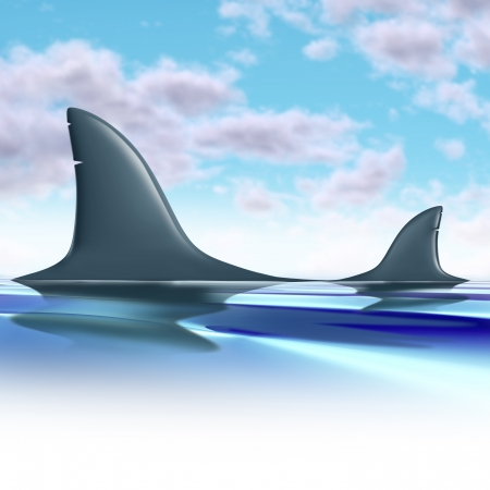david and goliath: Competitive advantage and competition symbol represented by two opposing shark dorsal fins competing with one being bigger than the smaller shark representing the concept of competition between two rivals of different sizes. Stock Photo