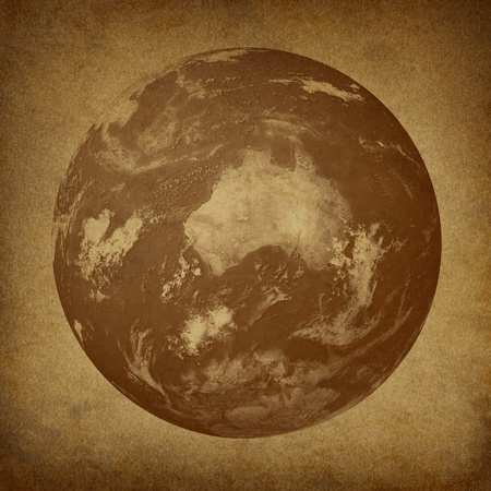 Planet Earth featuring Australia on a grunge old parchment paper texture. Stock fotó