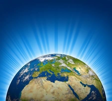 유럽은 밝은 광선 파란색 배경 지구 행성 지구 모델에 볼 수 있습니다.