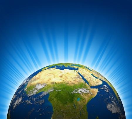 Afrika en het Midden-Oosten uitzicht op een planeet Aarde wereldbol model met een lichte radiale blauwe achtergrond.