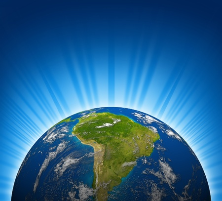 South america view on an Earth planet globe model with a bright radial blue background. photo