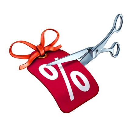 price cutting: Low interest rate cut represented by scissors cutting a red price tag with a percentage sign. Stock Photo