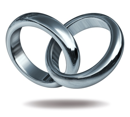 titanium: Rings linked together to form the silver and titanium shape of a heart representing the strong concept of love and eternity. Stock Photo
