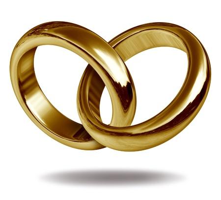 Anillos unidos entre sí para formar la forma de un corazón de oro que representa el concepto de amor y de la eternidad.