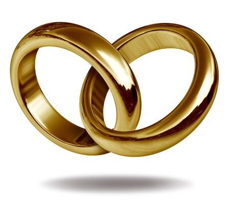 rings: Rings linked together to form the golden shape of a heart representing the concept of love and eternity.