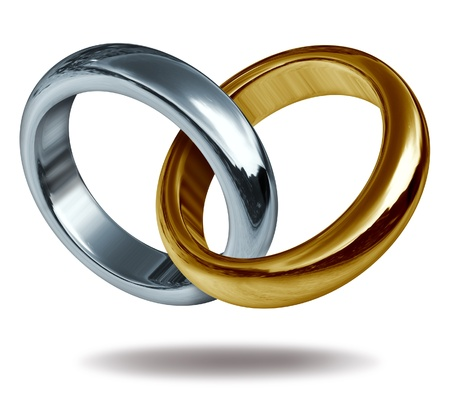 wedding rings: Wedding rings linked together to form a golden and titanium shape of a heart representing the concept of love and eternity.
