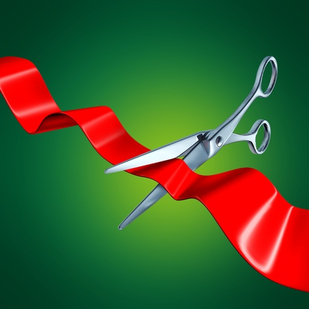 ribbon cutting: Cutting the ribbon with a green background representing a groundbreaking event. Stock Photo