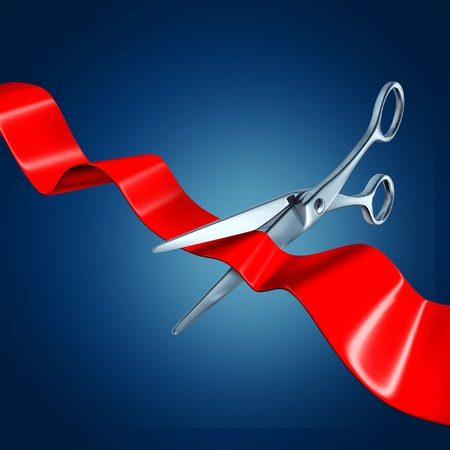 Cutting the ribbon with a blue background representing a grand opening event. photo