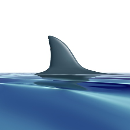 Risk symbol with shark fin above water representing future danger and risk from predators. Stock Photo