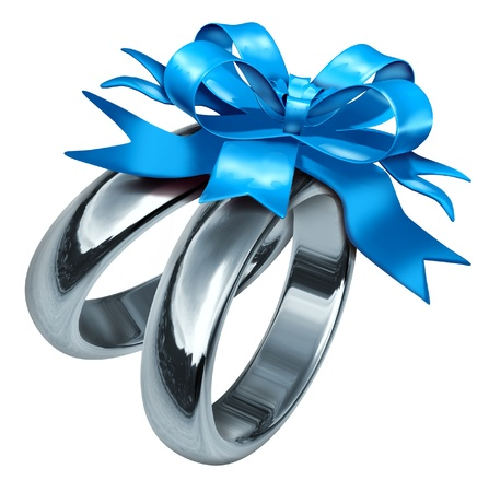 wedding rings tied with a blue bow symbolizing love and life partnership also representing marital celebration with a gift of silver and titanium jewelry. photo