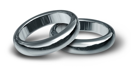 Two silver wedding rings resting on an isolated background representing the start of a new life and relationship. Stock Photo - 10909909