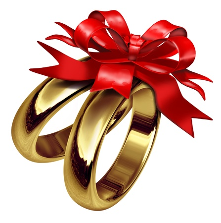 marital: Wedding rings tied with a red bow symbolizing love and life partnership also representing marital celebration with a gift of gold jewelry. Stock Photo