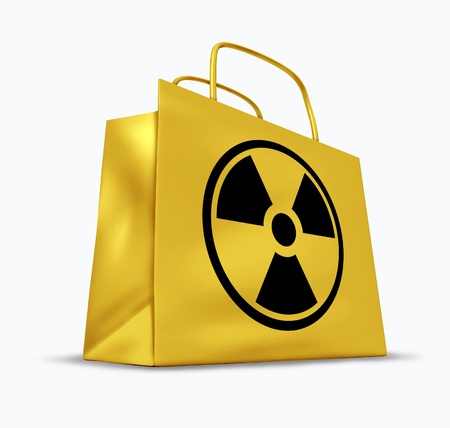ag: Radioactive and radiation contaminated goods and food groceries represented by a yellow shopping bag with a nuclear symbol. Stock Photo