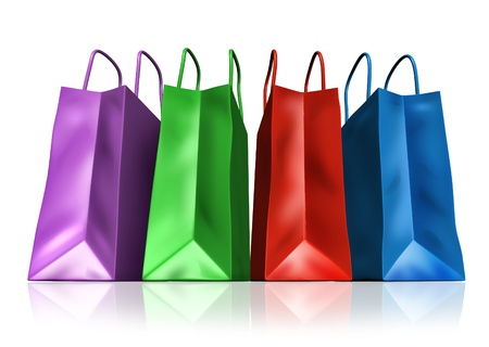 Shopping bags in a group of different colors representing retail sales and commercial purchases from malls and other department stores.