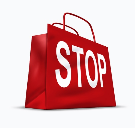 Stop shopping symbol of the economic problems of spending too much and falling into debt and bankruptcy caused by interest rates and a slow economy represented by a red shopping bag. Banco de Imagens