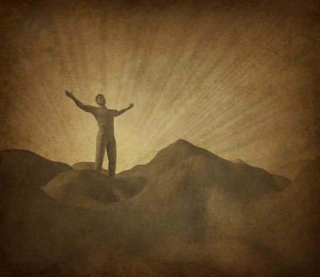 Faith and religion with old grunge paper parchment represented by a man on a mountain with his arms raised to the heavens in search of belief and spirituality.