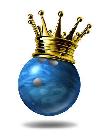 Bowling king champion symbol represented by a golden crown on a blue plastic marble bowling ball for bowlers representing the winning of a tournament or game at a bowling alley due to many strikes of the pins..