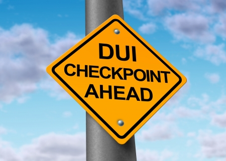 dui: Sobriety and drunk driving checkpoint representing the dangers of drivers that are intoxicated above the legal limit by alcohol or other drugs while they are behind the wheel of a vehicule.