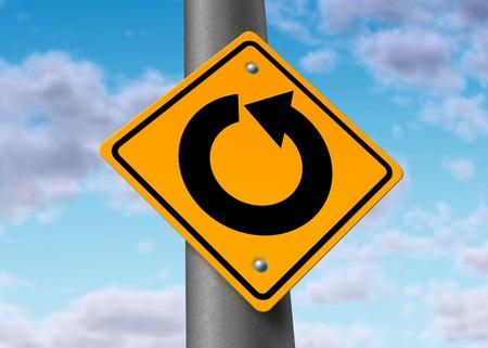 effort: return in circles confused nowhere futile waste of time effort road traffic sign yellow infinite loop Stock Photo