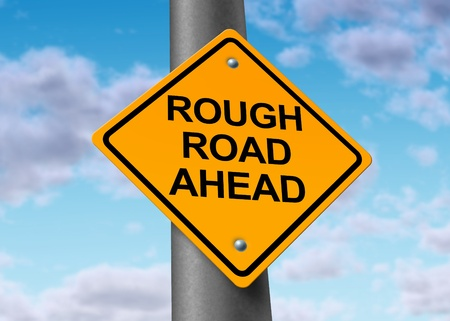 rough road: difficult rough road challenging ahead yellow street sign Stock Photo