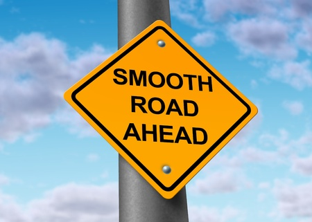 good times: smooth road ahead good times recovery yellow street sign Stock Photo