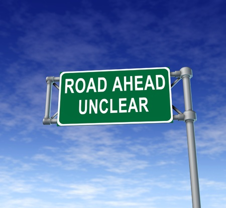 unsure: Road ahead unclear green freeway sign representing uncertainty in financial business. Stock Photo