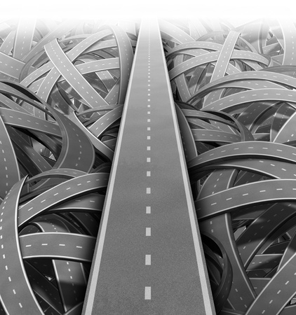 Cut through the mess for Solutions and success with clear vision and strategy due to careful planning and management building a road bridge over a maze of tangled mess of roads and highways cutting through the confusion and succeeding in business and life Stock Photo