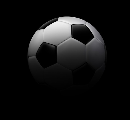 Soccer football symbol on a black background represented by a black and white soccer ball showing the theme of sports and leisure outdoor recreation and fitness icon for athletes and team members of a competitive tournament squad. Stock Photo - 11359713