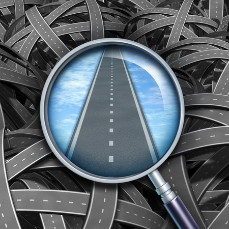 Answers and solutions with a clear path and direction to business questions represented by confused tangled roads with a transparent magnifying glass guiding the way forward with a straight road of success.