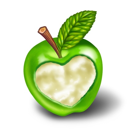 Healthy living and good diet with natural food and exercise symbolised by a green apple with a heart shape carved into the ripe delicious fruit as a symbol and concept of healthcare and eating whole foods from nature on white. photo