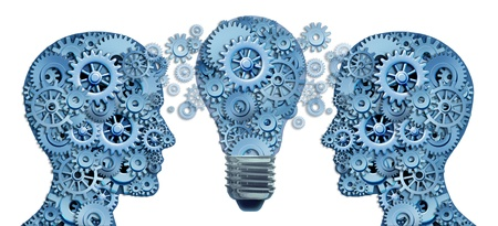 Lead and Learn Innovation strategy with two human brains working together as a business team to find solutions and answers to challenges showing gears and cogs with an innovative  ligthbulb concept of new ideas. Stock Photo