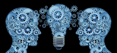Working together as a team for innovative strategies and creating new ideas and products through lesdership and education represented by two human heads and a lightbulb in the shape of gears and cogs . photo
