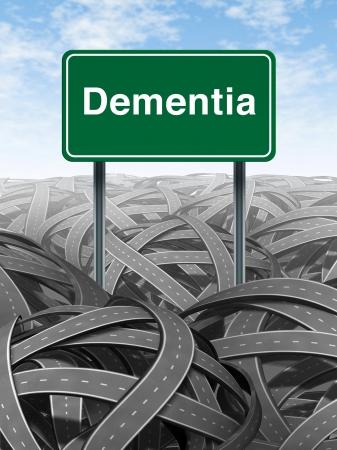 enfermedades mentales: La demencia y el concepto de la Enfermedad de Alzheimer médica con un signo de carretera camino verde con el texto en referencia a la pérdida de memoria y los problemas del cerebro humano con las carreteras y calles retorcidas enredadas en un símbolo de la confusión. Foto de archivo