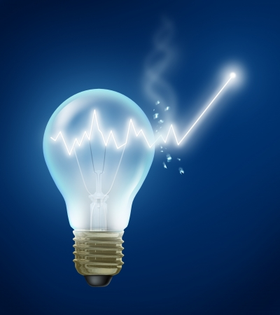 Investment Ideas and stock market concept with a shining light bulb with a stock graph chart as a bulb filament bursting out of the glass showing new growth and future success in business and finance.