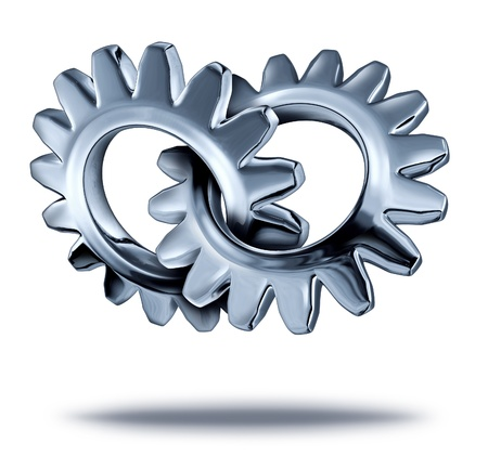 acquisition: Business partnership concept with two chrome metal gears or cogs connected together as a symbol of strategic corporate merger and  company teamwork.