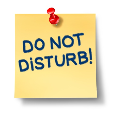 inconvenience: Do not disturb yellow paper office note with a red thumb tack as a warning sign to be quiet and not noisy to allow for relaxation and silence in a peaceful healthy environment with no sound pollution.