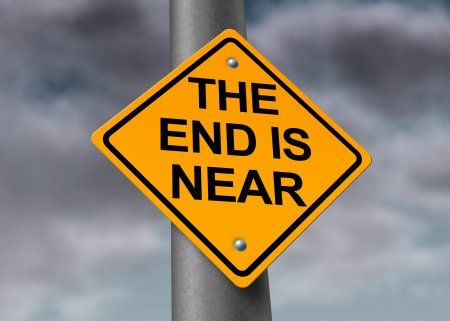 superstitions: The end is near road and armageddon sign with a dark stormy cloud background as a warning symbol of a great disaster that will result in great distruction of the world and final extinction of man on the fragile planet. Stock Photo