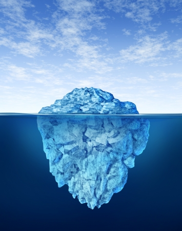 Iceberg floating in cold arctic ocean water with a small part of the frozen ice mountain above sea and a huge much larger peice of the freezing snow under the water as a misleading hidden cold winter obstacle as more than meets the eye..