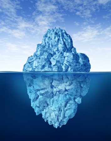 Iceberg floating in cold arctic ocean water with part of the frozen ice mountain above sea and other part of the freezing snow under the water as a cold winter obstacle.