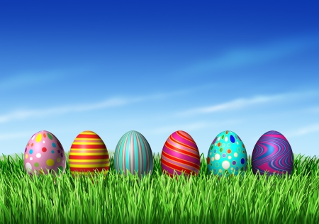 easter decorations: Easter Egg hunt with easter eggs in a row sitting on green grass and blue sky as a symbol of spring and the a holiday decoration and design element of the renewal season.