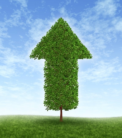 good times: Growth investing and financial business success during economic good times due to compound interest from investments for linear productivity developement with a green tree in the shape of an arrow pointing upwards to the blue sky. Stock Photo