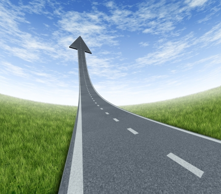 Success highway rising to the top as a road to financial freedom and prosperity moving up with a sky is the limit symbol and a path blasing off  to the air with an arrow head pointing upward on a summer landscape with forced perspective. Stock Photo