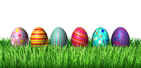 easter decorations: Decorated Easter Egg hunt with painted easter eggs in a row sitting on green grass on a whiote background as a symbol of spring and a holiday decoration and design element of the renewal season. Stock Photo
