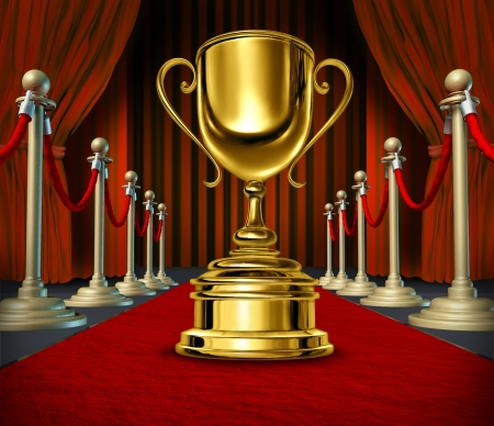 Golden Cup On a red Carpet with velvet Curtains as a reward for a cinema show or theater performance on  a broadway stage or movie screening as a best of show  and VIP treatment or start treatment. photo