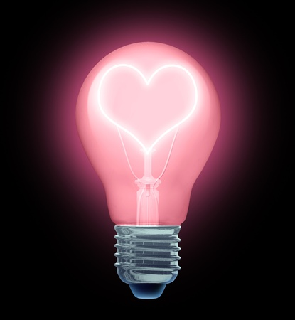 Love ideas and dating tips and advice for lovers and people in loving romantic relationships and creative sexy solutions to elebrate your valentine day with a lightbulb with the illuminated filament in the shape of a heart. Stock Photo - 12354008