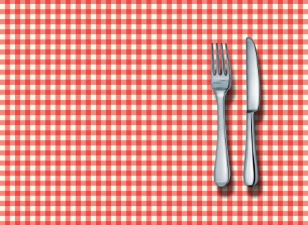 Family restaurant place setting with a classic red and white checkered table cloth with a silver fork and knife as a symbol of fine italian food cuisine and traditional americana fast food eateries.