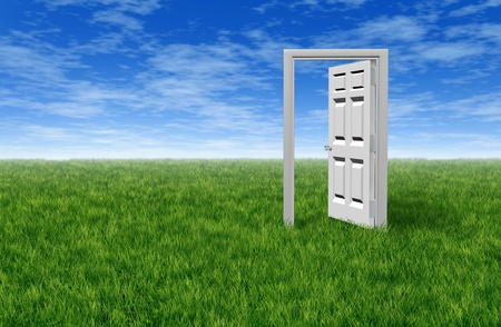 Door to opportunity with a grass field  and an open door to success and freedom showing the entrance to hope and prosperity for business and family photo